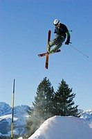 Skier performing iron cross stunt