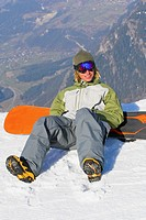 Snowboarder resting