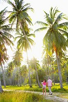 Malaysia, Pulau Langkawi  couple and girl6-8 walking through park