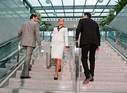 Businessmen and business woman on staircase