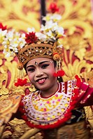 Indonesia, Bali, Ubud, child dancer in colorful outfit and floral gold headdress