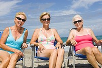 Three senior women in beach chairs