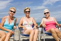 Three senior women in beach chairs