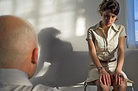 Businessman interviewing anxious businesswoman