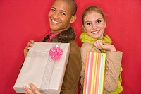 Couple holding out gifts