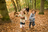Girl running with family in the woods