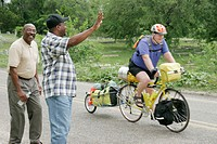 Mobile, Africa Town, Welcome Center, Underground Railroad Bicycle Route, cyclist, Black males wave. Alabama. USA.