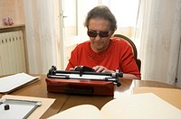 blind woman and braille typewriter, nembro, italy
