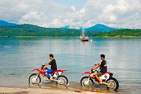 Motorcyclist by the lakeside, Malaysia