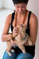 Portrait of woman with small dog