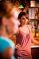 Portrait of young woman at bar