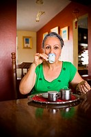 Portrait of a mature woman drinking a cup of tea