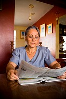 Mature woman reading a newspaper