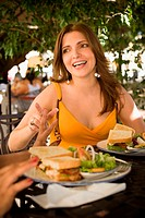 Mid adult woman sitting in a restaurant and smiling