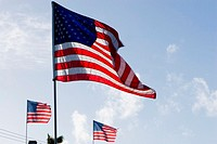 Low angle view of three American flags fluttering