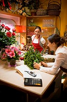 Two women working in flowers shop