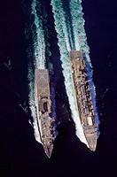 The fast combat logistic support ship USNS Supply (T-AOE 6), left, conducts an underway replenishment with USS Comstock (LSD 45) Nov. 22, 2006. Supply...