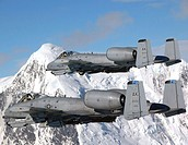 Two A-10 Thunderbolt IIs fly over the Pacific Alaska Range Complex April 24 during live-fire training. The A-10s are from the 355th Fighter Squadron f...