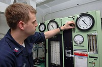 USS KITTY HAWK, at sea (July 26, 2007) - Aircrew Survival Equipmentman 2nd Class James Hardy, 23, from Webster, N.H., adjusts the gauges on a oxygen r...