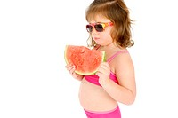 Girl with sunglasses eating water-melon
