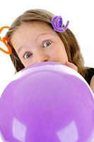 Girl blowing up a purple balloon