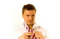 Businessman tying his tie