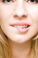 Teenage girl biting her lip