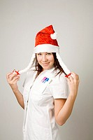 Female doctor with santa hat posing for the camera (thumbnail)