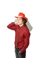 Man posing with briefcase and cowboy hat (thumbnail)
