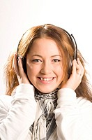 Woman with headphones smiling at the camera