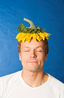 Man with sunflower on his head