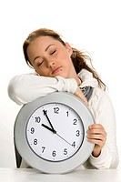 Teenage girl sleeping on clock