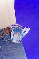 Money sticking out of pants pocket