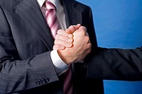 Close up of handshake by businessmen