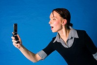 Woman stretching her arm taking picture with her mobile phone (thumbnail)