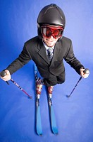 Playful businessman posing with ski gears