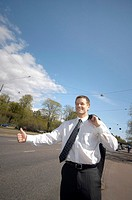 Businessman hitchhiking