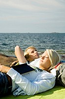 Couple relaxing by the seaside