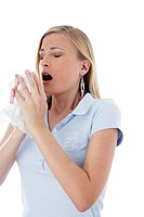 Woman holding tissue paper about to sneeze