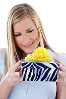 Woman smiling while looking at her present