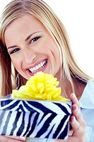 Woman smiling while showing off her present