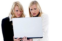 Businesswomen in shock while using laptop