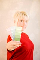 Woman showing colour swatches