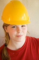 Teenage girl with safety helmet smiling at the camera
