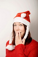 Teenage girl with santa hat in shock