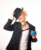 Businesswoman posing with a hat while holding a cup
