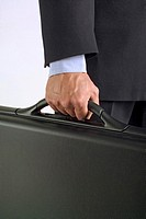 Midsection of man holding a briefcase