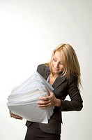 Businesswoman balancing a stack of paperwork
