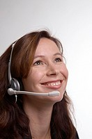 Businesswoman with telephone headset smiling