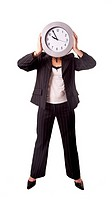 Businesswoman holding a clock as her face
